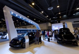 Man reaches settlement for $4.9M for injuries sustained from an auto show display wall falling onto him.